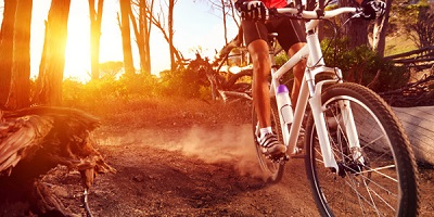 Best Mountain Bike Shoes biking through the trails