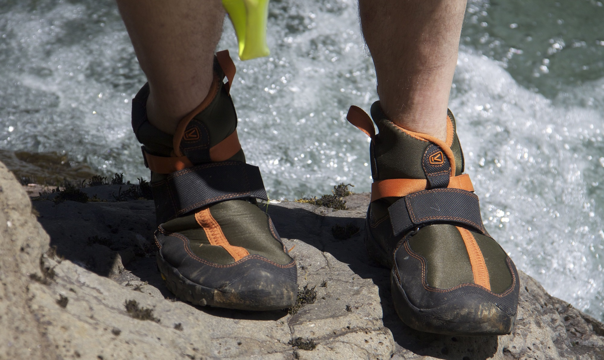 Best-Water-Shoes-stepping-on-rock-coming-out-of-river