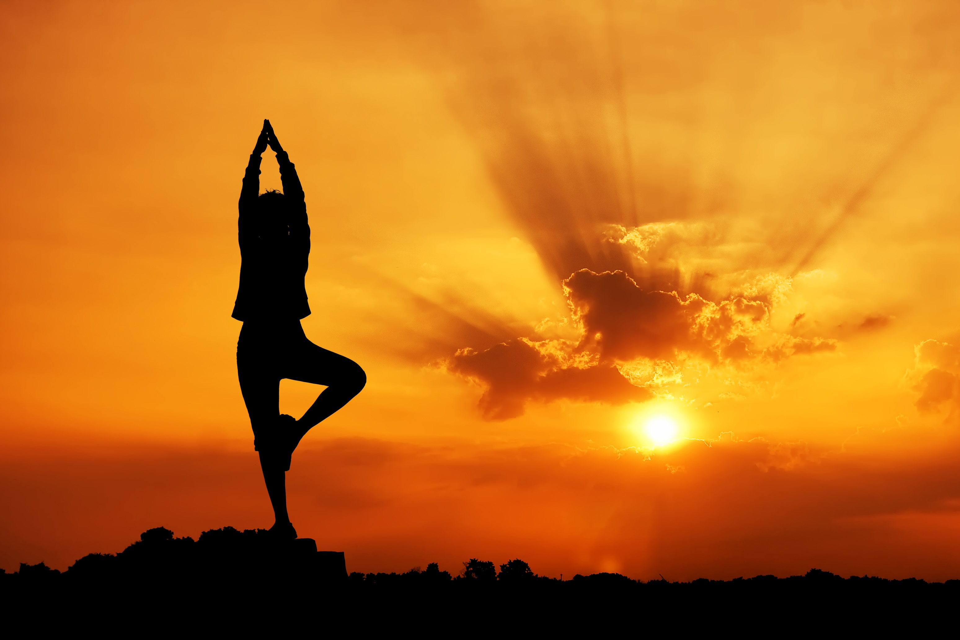 Best-Yoga-Shoes-woman doing yoga at sunset