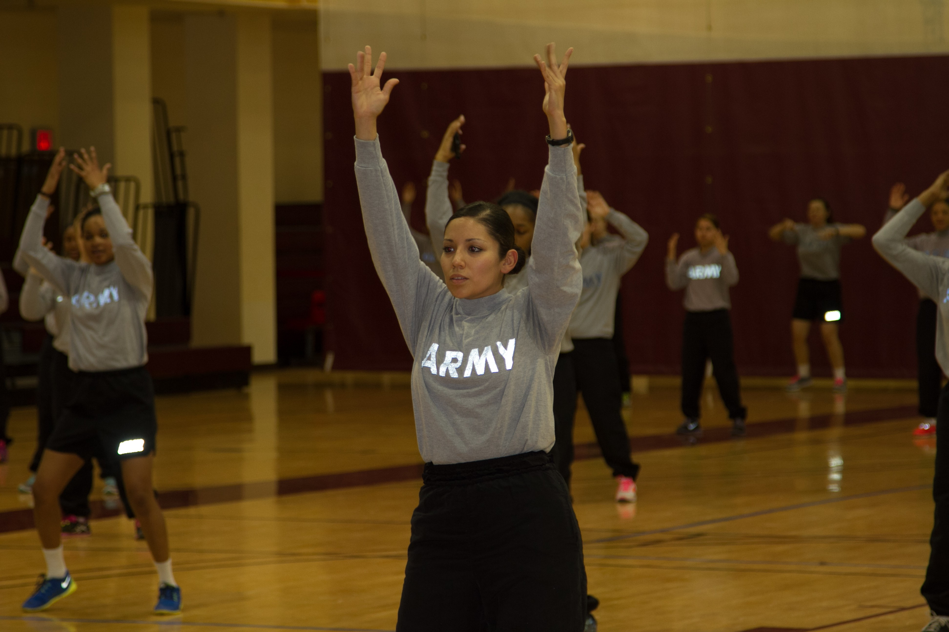 Female Soldiers from 2nd Combat Aviation Brigade perform dance during Zumba class