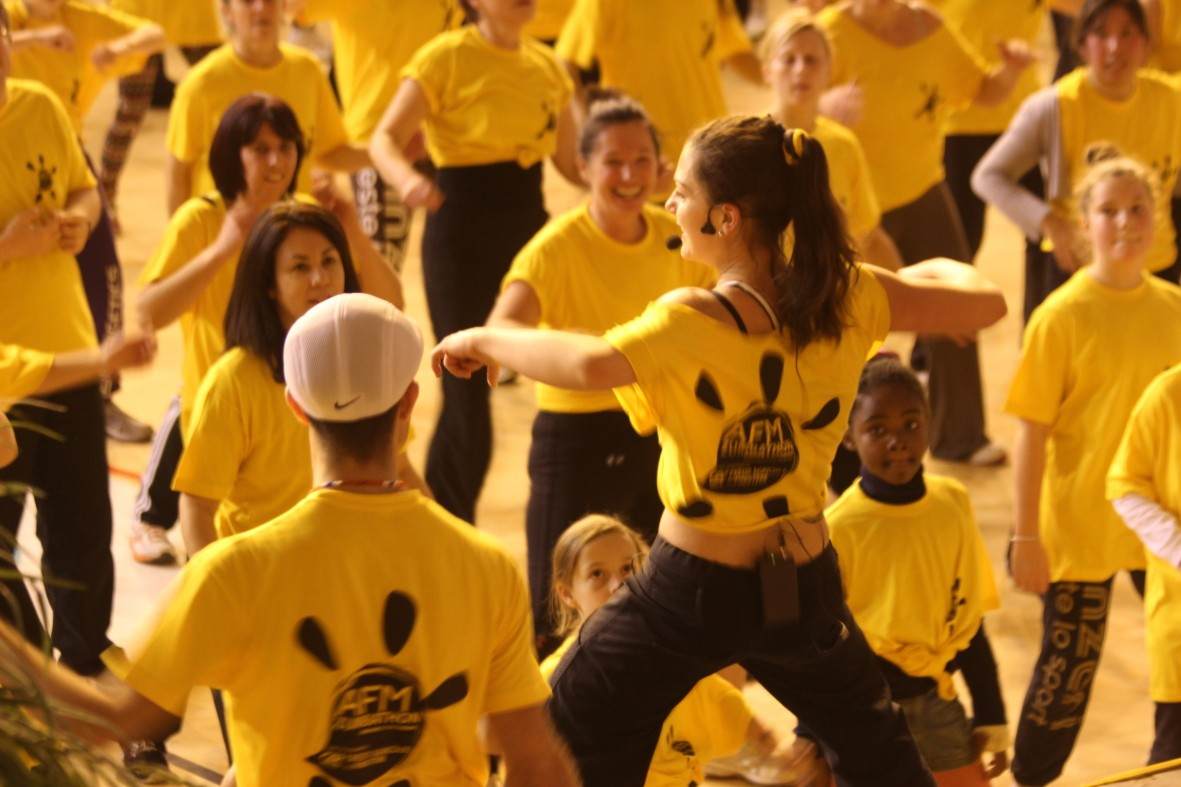 A photograph from Zumbathlon with a large group of people performing a dance