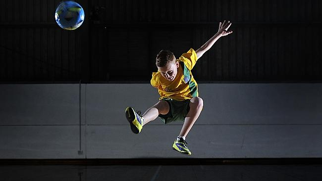 best-futsal-shoes-boy shooting for a goal