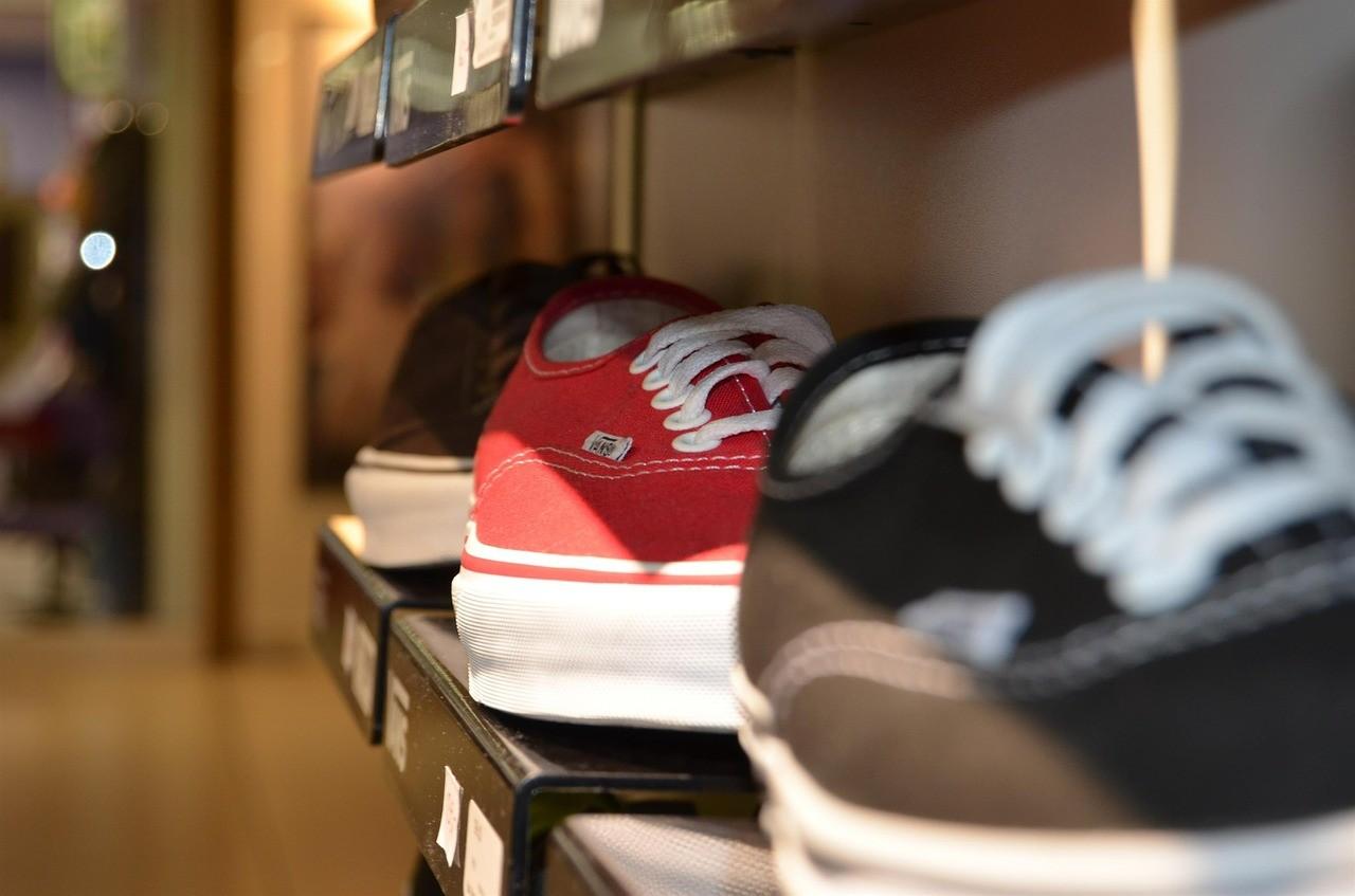 Three similar shoes on a shelf