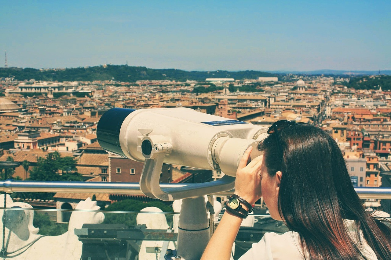 Woman looking into a spyglass