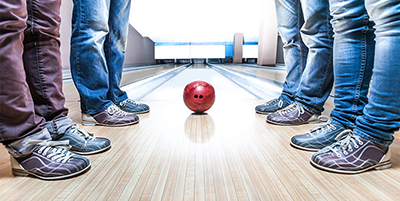 Best-Bowling-Shoes-Bowlers-Standing-At-Lane-With-Bowling-Ball