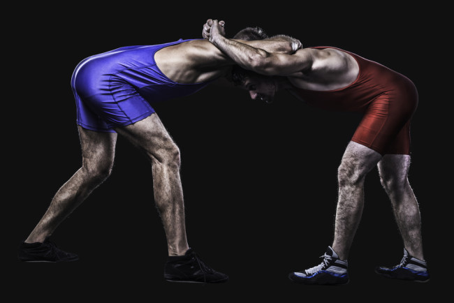 Best Wrestling Shoes -Two freestyle wrestlers in red and blue wrestling uniform isolated on black background