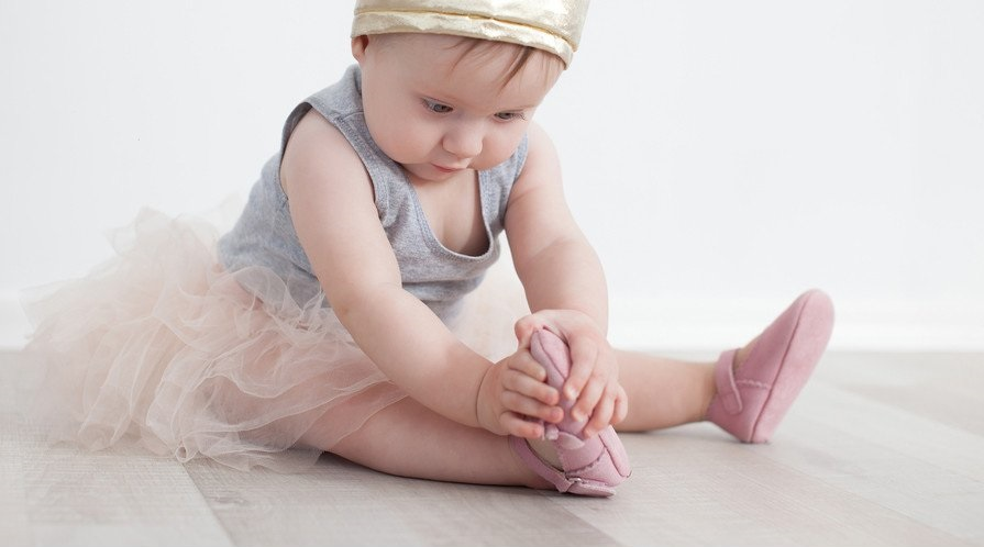 Best-Baby-Shoes-Baby-Girl-Dressed-Up-as -princess-looking-at-shoe