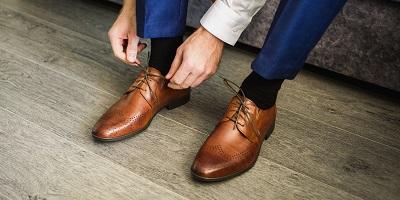 best dress shoes man tying fancy shoes
