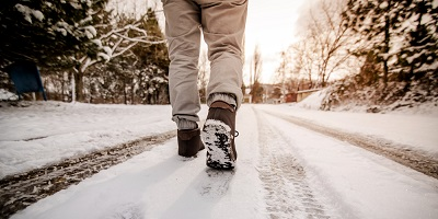best winter boots-man walking in the snow
