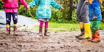 Best-Wellington-boots-Family-in-puddle-in-rain-boots