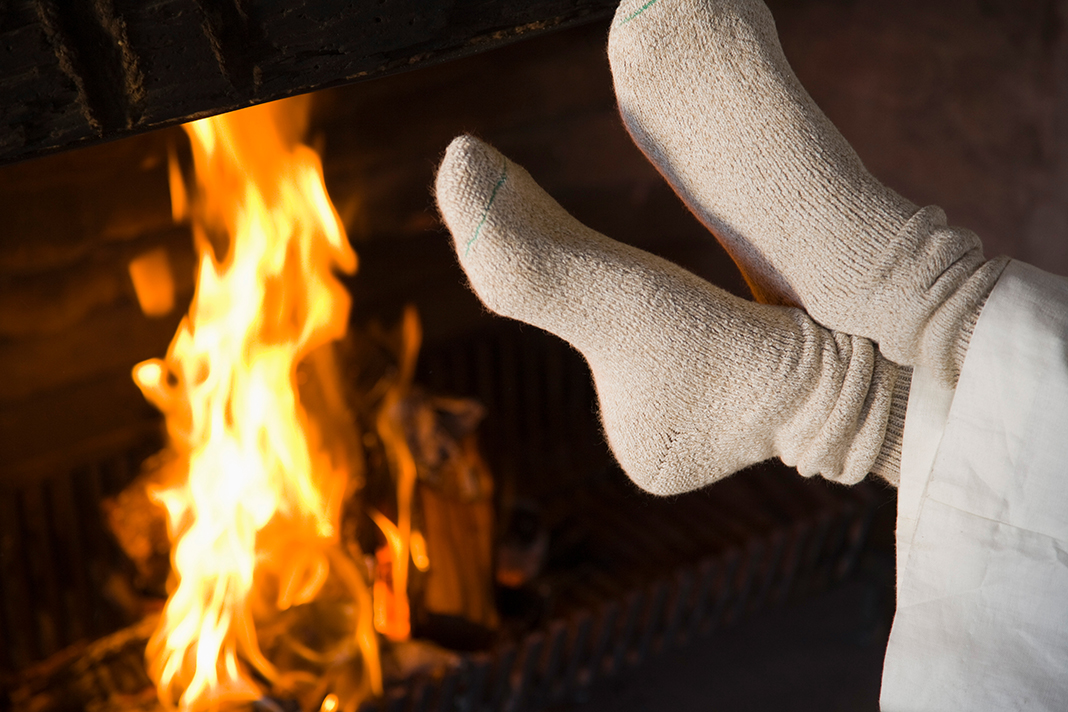 Feet by fireplace