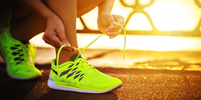 Best-Running-Shoes-Woman-Runner-Tying-Yellow-Running-Shoes