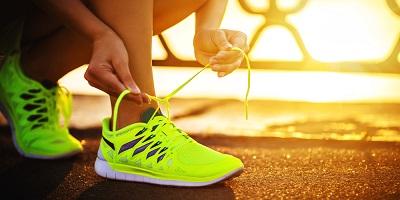 Best-Running-Shoes-Woman-Runner-Tying-Yellow-Running-Shoes