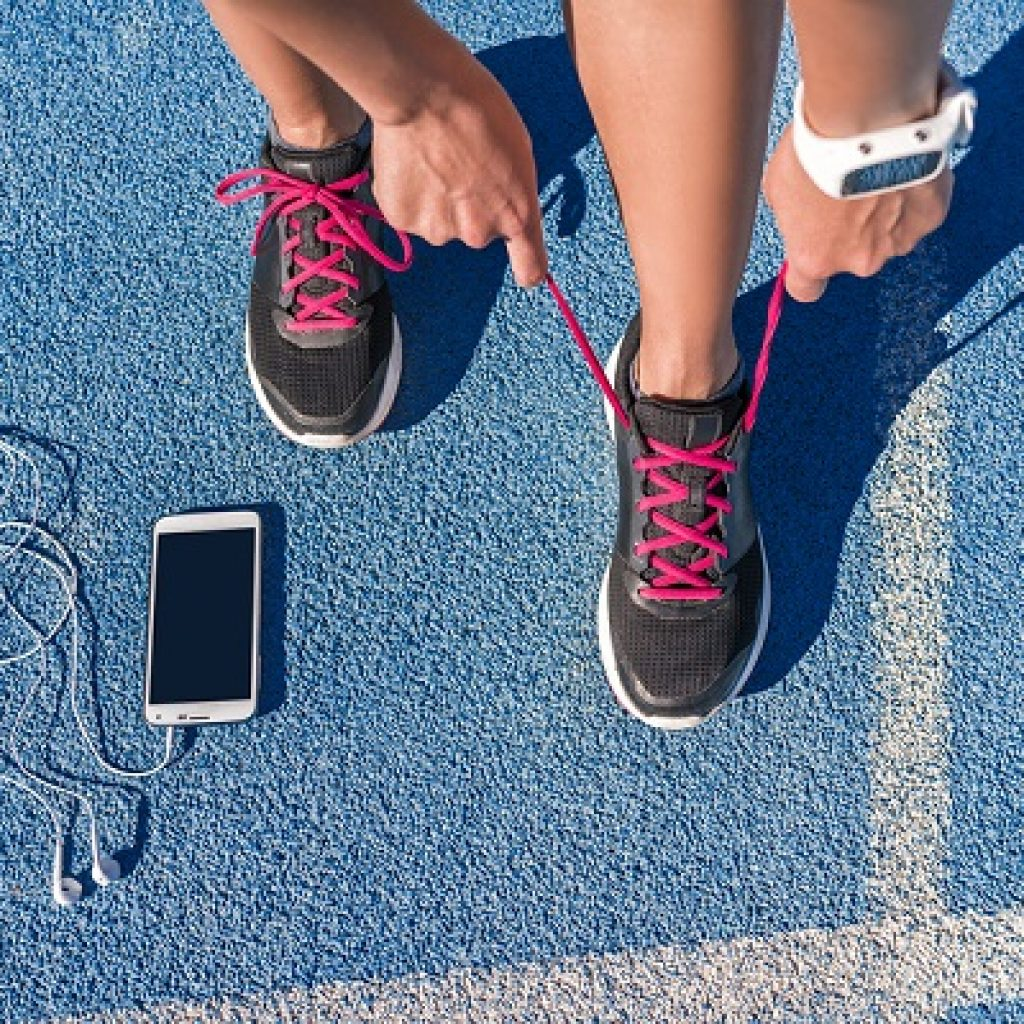 runner-tying-shoes-on-a-track-best-running-shoes