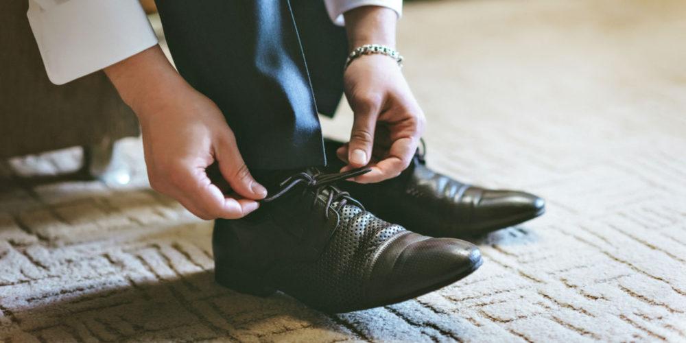 Best Formal Shoes-man tying formal shoe