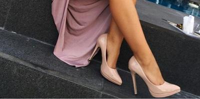 Best Pumps - woman sitting wearing high heels
