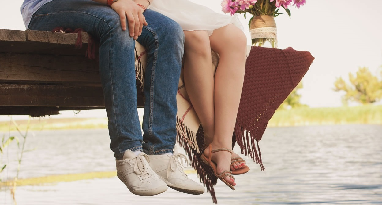 Best Summer Shoes - couple sitting on pier