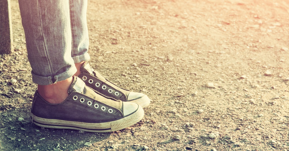 best converse shoes - peson wearing converse shoes