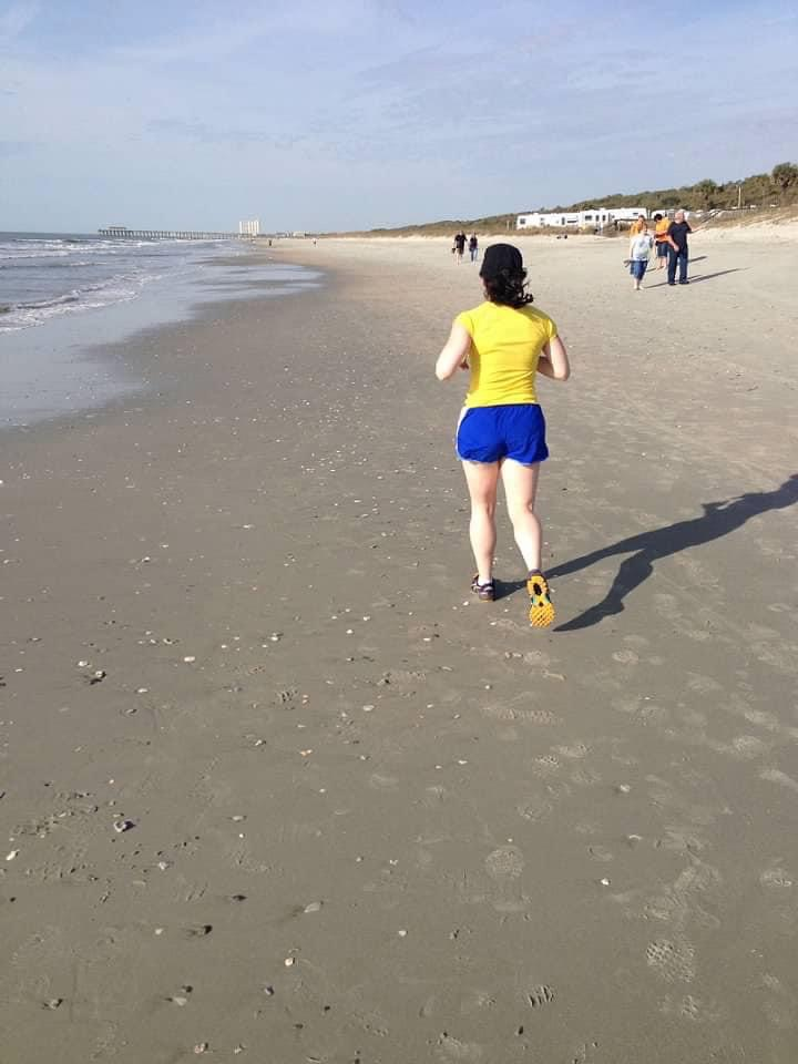 Stephanie Justus running on sand